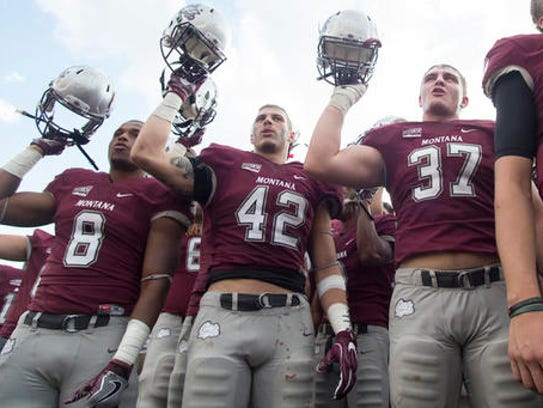 Montana players sing the school fight song after playing