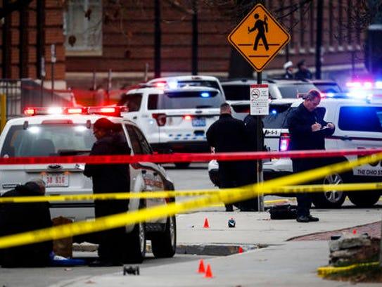Crime scene investigators collect evidence from the