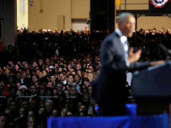 Supporters listen as President Barack Obama speaks