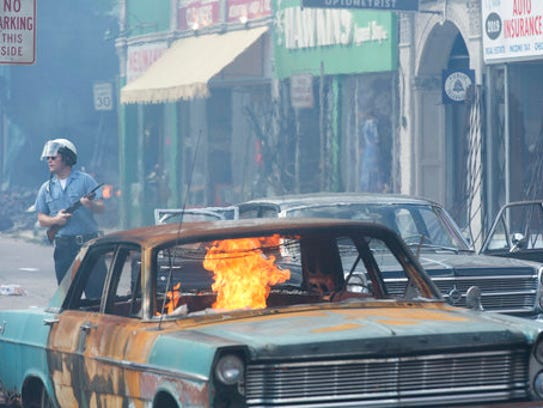 This image shows a scene from the 1967 riots drama