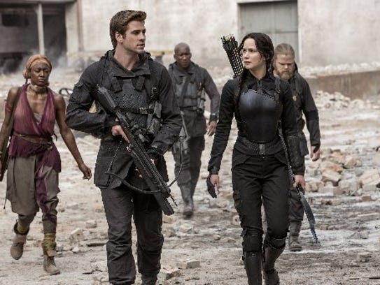 Jennifer Lawrence portrays Katniss Everdeen, right,