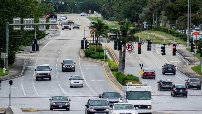 Traffic heads west on Indiantown Road across U.S. 1 in Jupiter on Wednesday, Nov. 13, 2019.