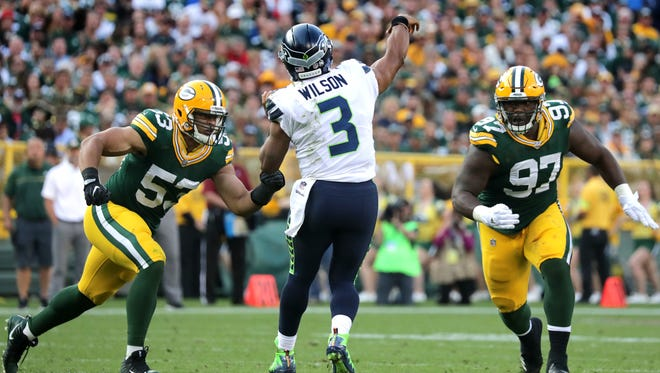 Green Bay Packers linebacker Nick Perry (53) and defensive lineman Kenny Clark (97) rush Seattle Seahawks quarterback Russell Wilson (3) on Sunday, September 10, 2017, at Lambeau Field.