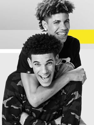 Lonzo and LaMelo Ball pose for their new docu-series family reality show airing Aug. 31 on Facebook.