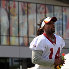 Washington Redskins wide receiver Donte' Stallworth (14) runs onto the field prior to a morning walkthrough as part of the 2013 NFL training camp at the Bon Secours Washington Redskins Training Center.