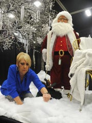 Cindy Kafer of The Last Straw fluffs fake snow while decorating the front stage of this year's Christmas Magic event at the Ray Clymer Exhibit Hall. The Christmas shopping event features vendors from the region with many unique items. Friday and Saturday, 9 a.m. to 7 p.m. and Sunday, Noon to 5 p.m.