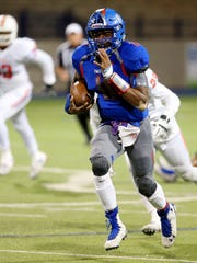 Americas' Joshua Allen moves the ball up the field Friday night during a Class 6A Division II Region I area playoff game against San Angelo Central at Grande Communications Stadium in Midland.