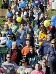 Participants of the Under the Big Sky Buddy Walk make