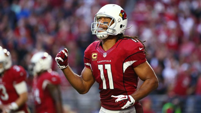 Cardinals Larry Fitzgerald reacts with relief Michael Floyd after made a touchdown catch against Redskins in the second half on Dec. 4, 2016 in Glendale, AZ.