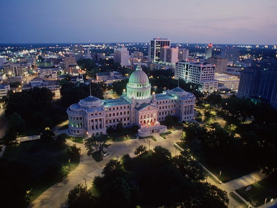 State Capitol and downtown Jackson skyline at dusk.