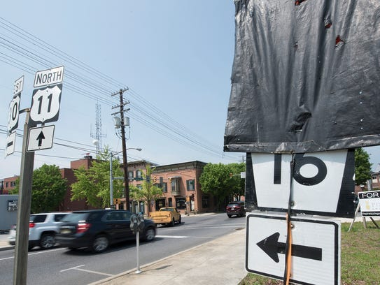 A covered sign is seen along Second Street and Lincoln