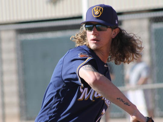 Milwaukee Brewers pitcher Josh Hader warms up before beginning drills with his team at Maryvale Baseball Park in Phoenix. His hair is quite curly in this photo from February 2017.