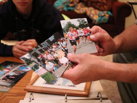 Brian Koenig, Pam's husband, shows some photographs