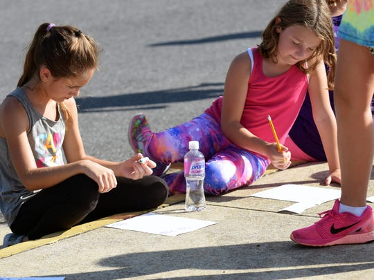 Two girls write down their thought and feelings after