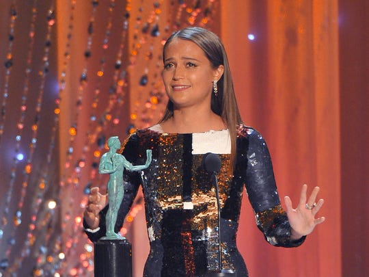 "Alicia Vikander accepts the award for outstanding female actor in a supporting role for ""The Danish Girl"" at the 22nd annual Screen Actors Guild Awards."