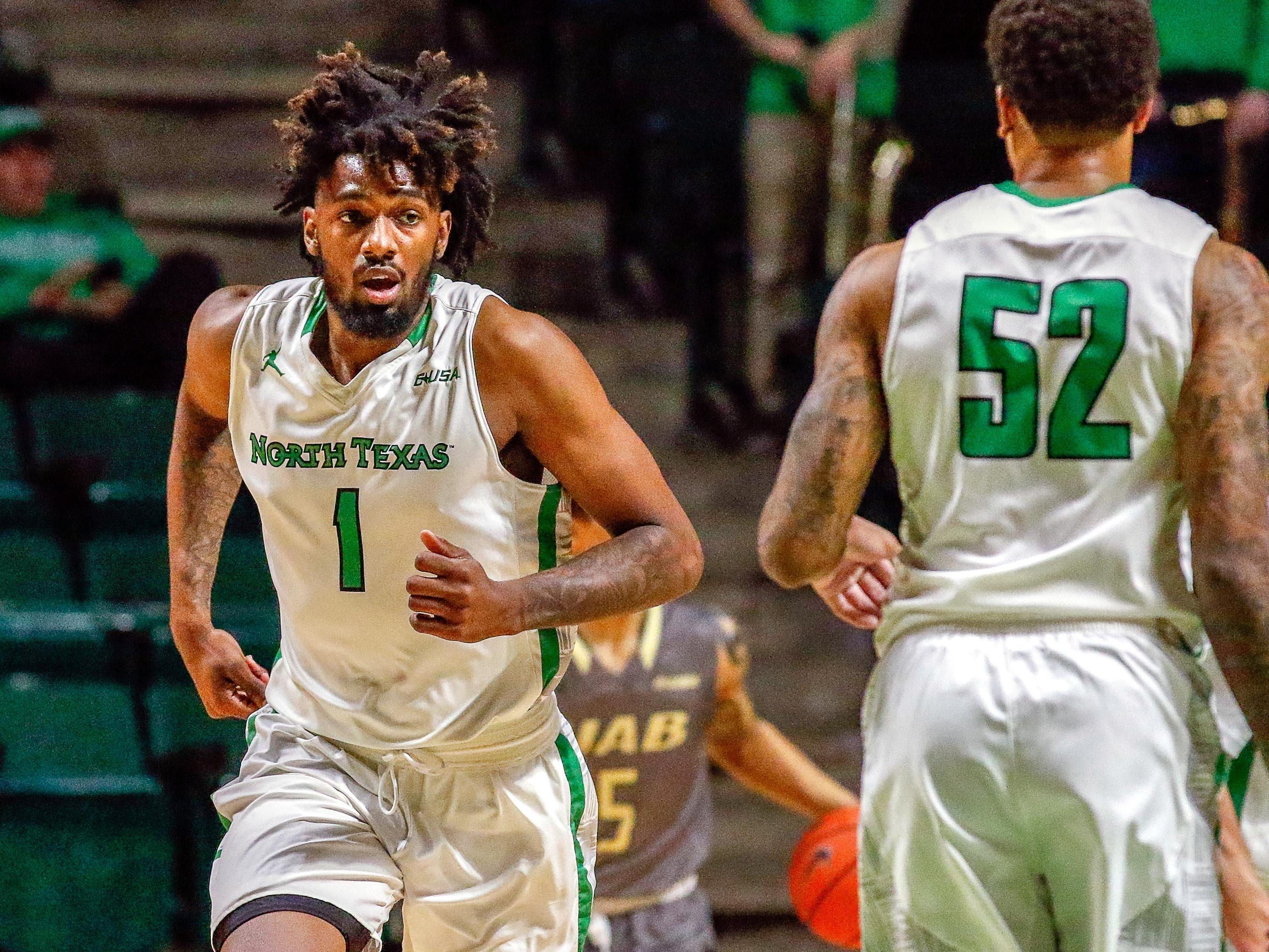 North Texas Mean Green forward Jeremy Combs (1) runs back up court after a made basket against the UAB Blazers during the second half at UNT Coliseum.