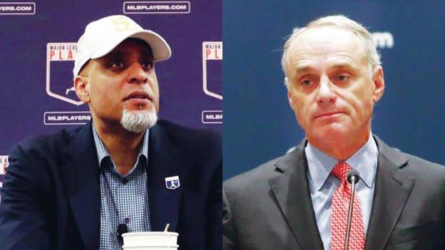 Major League Baseball Players Association Executive Director Tony Clark, left, and Major League Baseball Commissioner Rob Manfred