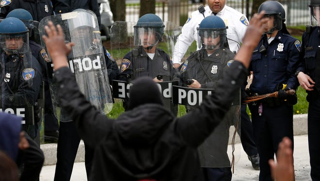 BALTIMORE, MD - APRIL 27: Protestors on Reisterstown Road near Mowdamin Mall, April 27, 2015 in Baltimore, Maryland. The funeral service for Freddie Gray, who died last week while in Baltimore Police custody, was held on Monday morning. (Drew Angerer/Getty Images)
