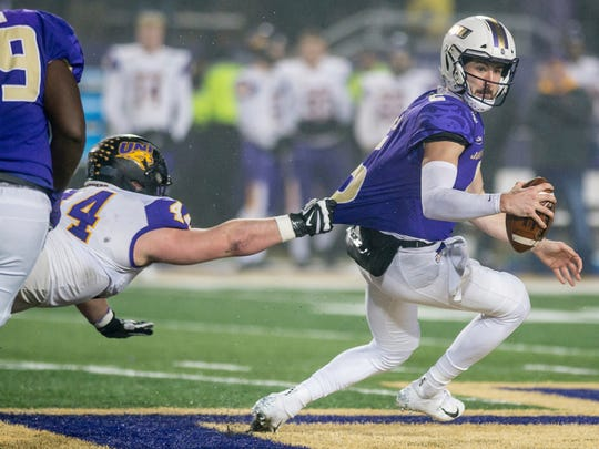 Northern Iowa defensive lineman Jared Brinkman (44) grabs onto James Madison quarterback Ben DiNucci (6) during the first half of a quarterfinal game in the NCAA college Football Championship Subdivision playoffs in Harrisonburg, Va., Friday, Dec. 13, 2019. (Daniel Lin/Daily News-Record via AP)