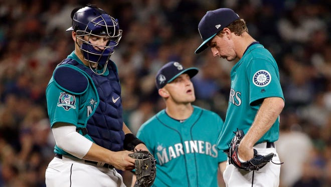 Andrew Moore, right, will start for the Mariners on Wednesday against Houston.