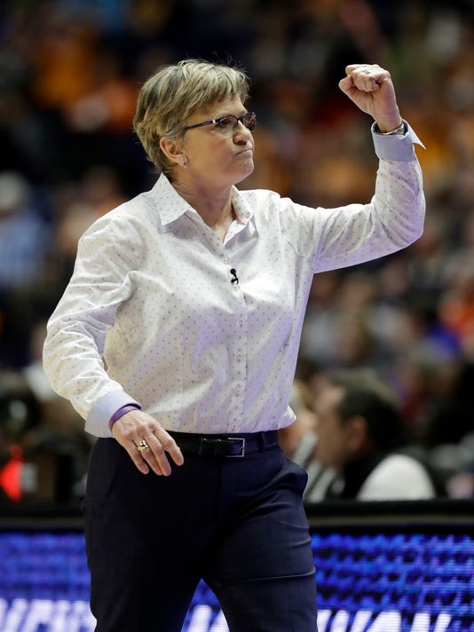 Tennessee head coach Holly Warlick celebrates after a score against Auburn in the first half of an NCAA college basketball game at the women's Southeastern Conference tournament Thursday, March 1, 2018, in Nashville, Tenn. (AP Photo/Mark Humphrey)