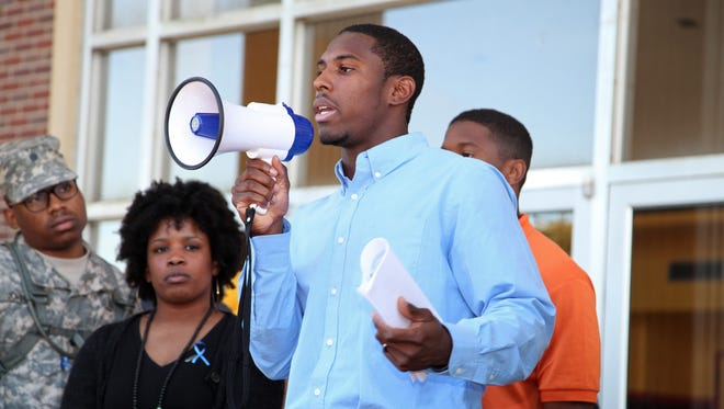 "Grambling State University football player Naquan Smith speaks at a ""State of Emergency"" gathering in Grambling, La."