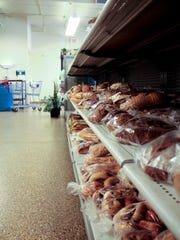 Bread products are seen on the shelf at St. Vincent