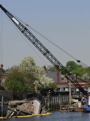 A crane and barge along a partially collapsed seawall along the Byram River in Port Chester. The estimated $7 million cost of the repairs has been the subject of a dispute between the village, Westchester County and developers G&S Investors. In 2013, G&S donated $22,500 to a campaign committee maintained by Westchester Democratic Chairman Reginald LaFayette, one month before the committee spent more than $25,000 to help defeat a village Republican slate that was pushing for G&S to pay for the repairs.