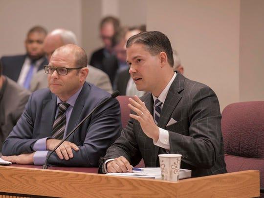 Attorney Eddie Greim speaks (right) while testifying