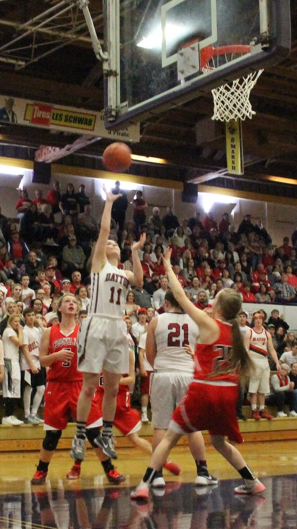 Dayton's Shawnie Spink (11) puts back a rebound against Coquille in the semifinals of the OSAA Class 3A state basketball tournament at Marshfield High School.