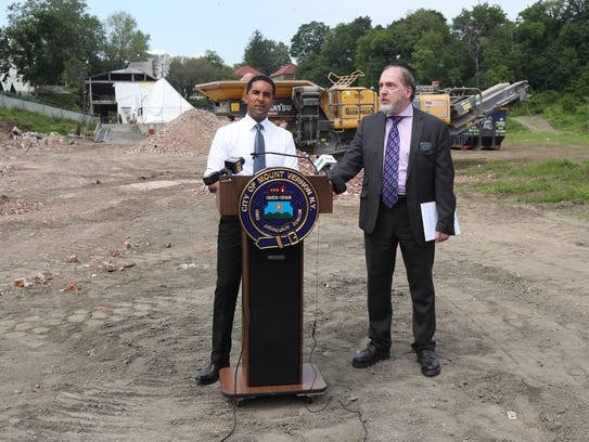 Mount Vernon Mayor Richard Thomas, left and corporation counsel Lawrence Porcari at a June 1 press conference about the demolition of Memorial Field and the tennis center. The collapsed tennis bubble, taken down overnight just hours earlier, is at rear on the left