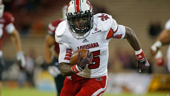 Louisiana Lafayette running back Elijah McGuire runs for yardage during the first half of an NCAA college football game against New Mexico State in Las Cruces, N.M., Saturday, Nov. 8, 2014. (AP Photo/Andres Leighton)