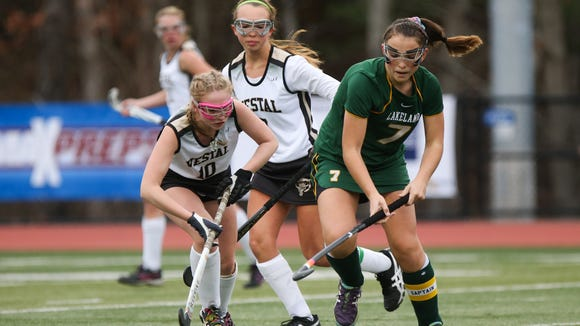Lakeland's Caroline Cahill (7) moves the ball from Vestal Erika Schutt (10) in the 1st half. Lakeland defeated Vestal 5-0 for the Class B Finals at Endwell. Nick Serrata - For The Journal News
