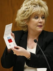 State Crime Lab scientist Sherry Culhane talks to jurors