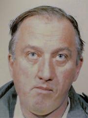 Kenneth C. Richmond shown in a 1985 booking photo