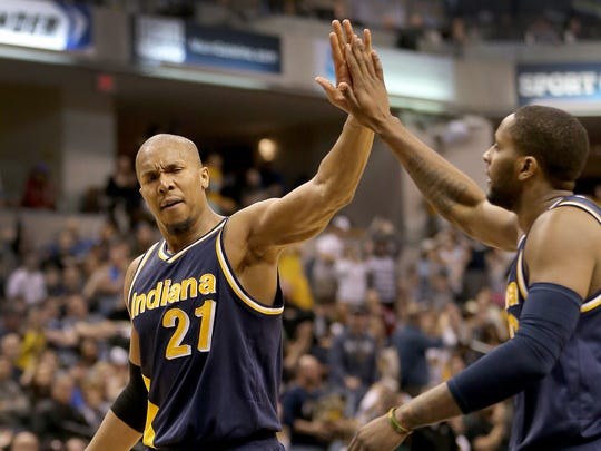 Indiana Pacers forward David West (21) -- high-fiving C.J. Miles in a 2015 game at Bankers Life Fieldhouse -- is the top free agent the franchise has signed.
