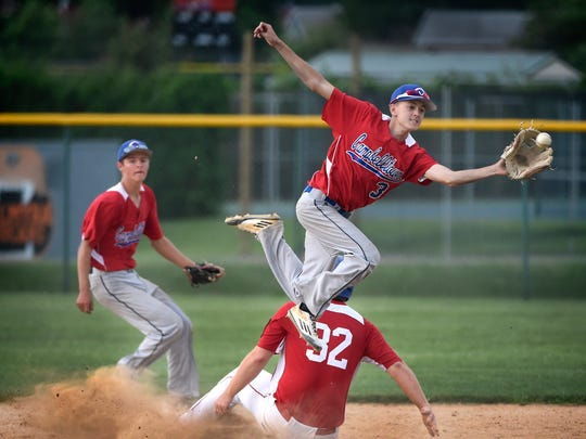 Campbelltown's Chris Good catches a throw as Annville's Mitch Long slides into second.