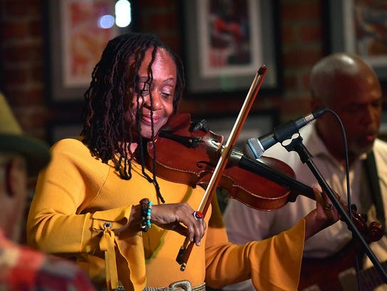 Jazz violinist Gwen Laster is shown in performance.
