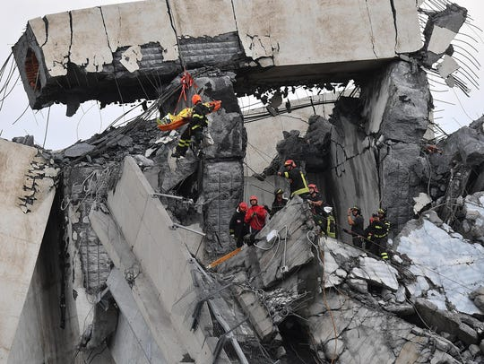 Firefighters rescue a person from the rubble of the
