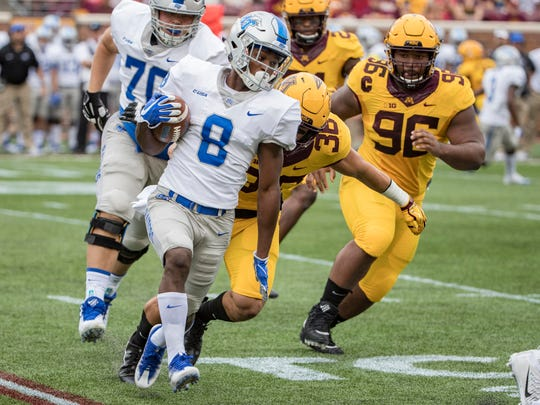 Sep 16, 2017; Minneapolis, MN, USA; Middle Tennessee Blue Raiders wide receiver Ty Lee (8) rushes with the ball as Minnesota Golden Gophers linebacker Blake Cashman (36) makes a tackle for no gain in the first quarter at TCF Bank Stadium. Mandatory Credit: Jesse Johnson-USA TODAY Sports