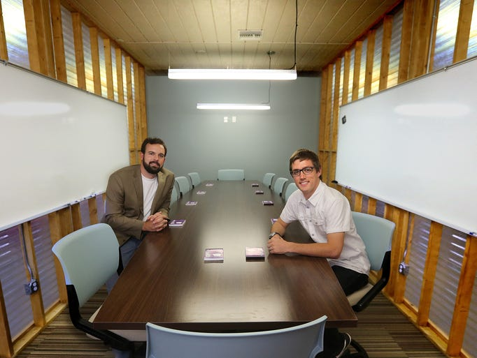 Micah Widen (left) and Lucas Lindsey show off one of the meeting rooms at the incubator facility on Railroad Avenue. The new small business incubator facility officially opened May 22 on Railroad Avenue.  Micah Widen  Lucas Lindsey and Jake Kiker were on hand to show  off the new facility that hopes to give new business ventures a space to coordinate their start up.  The incubator occupies a renovated warehouse that Leon County owns that is directly across from the Amtrak station.