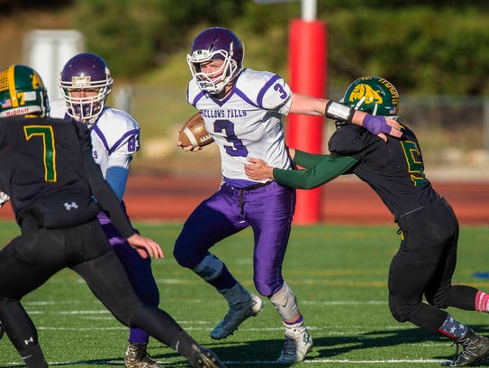 Logan Cota, center, and the Bellows Falls Union High School football team are one win away from securing back-to-back Division II titles.