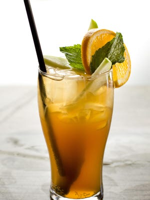 The Pimm's Cup is traditionally made with Pimm's liquor, ginger ale, lemonade, and served with mint leaves, an orange slice, cucumber, or apple slices. Serve it over ice.