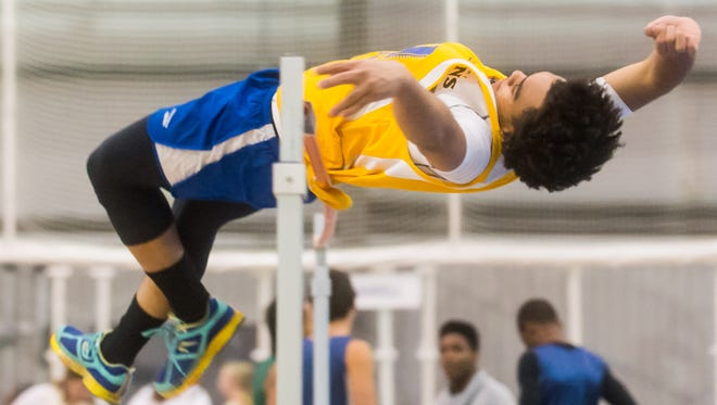 A Wicomico High jumper attempts to clear the high bar during the Bayside Indoor Track Championships at the Worcester County Recreation Center on Wednesday, Jan 20 in Snow Hill.