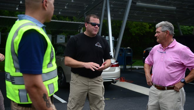 """(Middle) Brian Rossomanno, 311 Tactical, debriefs a training drill with (Right) John Reddington, Bear Trap Dunes HOA member, during the """"Officer for a Day"""" program working with the Ocean View Police Department designed to allow citizens to experience policing from an officer's perspective on Monday, July 17, 2017."""