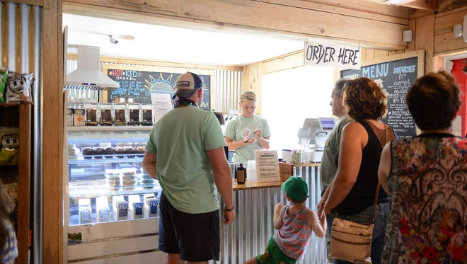 Assateague Island Surf Shop located on 611 in Berlin, Md.  Offers a variety of goods. From Surf Boards, Coffee, and sandwiches. Thursday, July 27, 2017