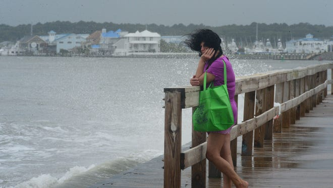 A woman's hair blows in the high winds in Ocean City, Md. where a summer nor'easter is passing through causing high winds, large waves and beach erosion on Saturday, July 29, 2017.