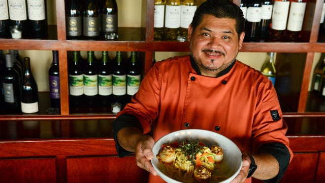 Solo's Head Chef Arturo Suazo prepares Seared Dry Sea Scallops that consist of, fresh jumbo scallops, sweet corn & Duroc bacon jam, summer vegetables, fresh trofie pasta, light white wine butter sauce on Tuesday, July 25, 2017.