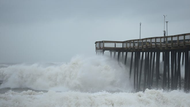 Waves roll under the Ocean City Fishing Pier on Tuesday, Sept. 19, 2017 during weather created by Hurricane Jose off the Atlantic Coast.