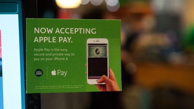 Whole Foods takes Apple Pay, but CVS, Rite Aid and other retailers are working with their own system, CurrentC, instead.